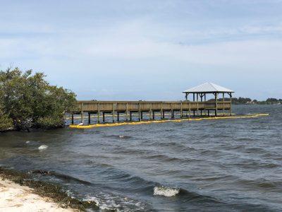 Custom Dock construction with slatted wood railing, hand rails and custom metal roof
