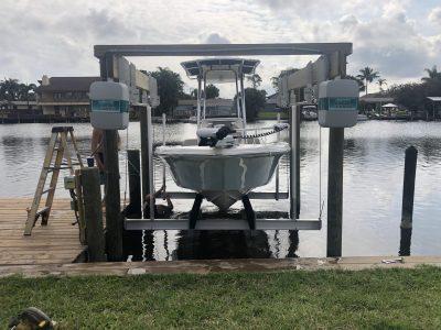Narrow property edge custom dock design with boat lift and loading dock