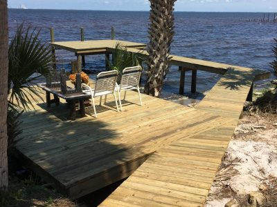Custom walkway, deck and dock design with fishing dock at the end and sitting deck over the shoreline