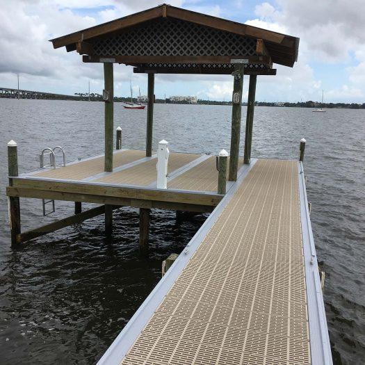 Loyd Custom Marine Dock Builder, Aluminum Dock Construction and Thru Flow Decking including Fishing platform with roof