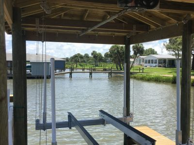 Boat Dock Builder Brevard County | This is a Boat Dock and Boat House with Roof and Boat lift